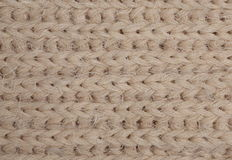 Beige knitted fabric Stock Image