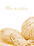 Beige knitted garnment and a ball of thread Royalty Free Stock Photos