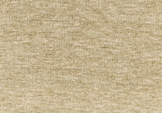 Beige knitted natural wool texture background. Stock Photo