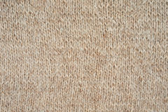 Beige knitted pattern. As a seamless background Royalty Free Stock Photos