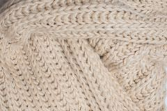 Beige knitted texture, top view stock photography