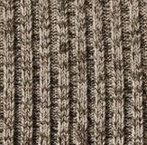 Beige knitted wool texture as background Stock Photos