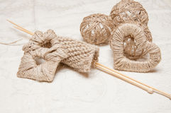 Beige knitting and jewelry made of thread Royalty Free Stock Images