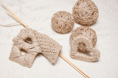 Beige knitting and jewelry made of thread Stock Images