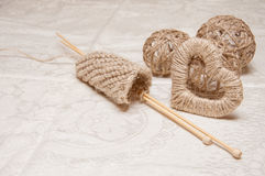 Beige knitting and jewelry made of thread Royalty Free Stock Photography