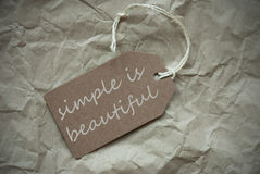 Beige Label With Quote Simple Is Beautiful Paper Background Stock Photos