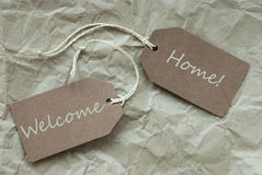 Beige Labels With Welcome Home Paper Background Royalty Free Stock Photography