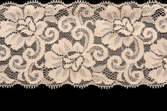 Beige lace with pattern flower. On black background Stock Images