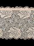 Beige lace with a pattern of large flowers Royalty Free Stock Photos