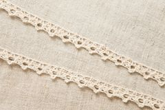 Beige laced linen. Beige linen folded tablecloth bordered with crocheted lace Royalty Free Stock Photo