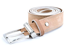 Beige leather belt 2. Beige leather belt with metal buckle on a white surface Stock Photos