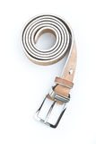 Beige leather belt 3. Beige leather belt with metal buckle on a white surface Stock Photos