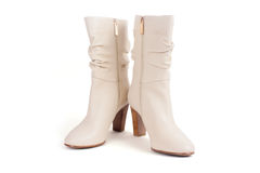 Beige leather boots Stock Images