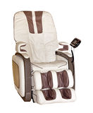 Beige leather comfortable reclining massage chair isolated Royalty Free Stock Photography