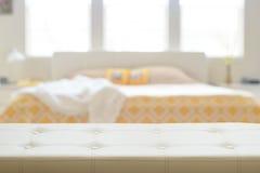 Beige leather empty bench in bedroom Stock Images