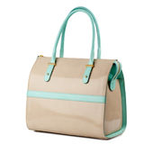 Beige leather handbag with turquoise handles isolated on white. Stock Photography