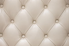 Beige leather sofa texture Royalty Free Stock Photos