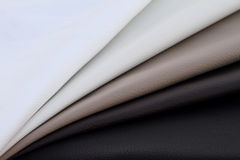 Beige leathers bended together. On sunlight Royalty Free Stock Photos