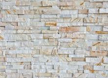 Beige or light brown colors tile marble wall texture.Wall pattern or abstract background. Stock Image