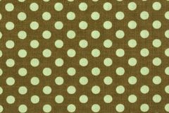 Beige with light green polka dots background pattern. Royalty Free Stock Photo