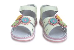 Beige light leather kids sandals. Royalty Free Stock Image