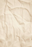 Beige linen fabric as background. In Sepia toned. Retro style Stock Image