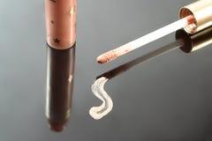 Beige lip gloss Stock Images