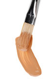 Beige liquid foundation makeup stroke with brush Stock Image