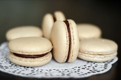 Beige macaroons with chocolate filling Royalty Free Stock Photography