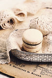 Beige macaroons and vintage wedding laces, retro effect Royalty Free Stock Photos