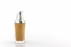 Beige make up foundation in luxurious bottle. Royalty Free Stock Photos