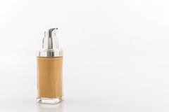 Beige make up foundation in luxurious bottle. Royalty Free Stock Photo
