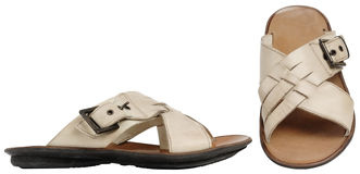 Beige man's sandals. Isolated on white background stock photography