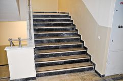 Marble stairs and railings. Beige marble stairs and stainless railings royalty free stock photos