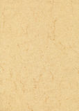 Beige marbled paper. A sheet of beige marbled paper Stock Photo