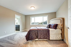Beige master bedroom with king size bed Royalty Free Stock Images