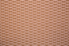 Beige material with abstract pattern, a background Royalty Free Stock Photos