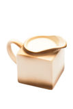 Beige milk jug Royalty Free Stock Image