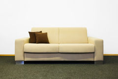 Beige modern sofa Royalty Free Stock Image