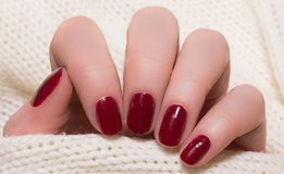Beige nails on white background royalty free stock images