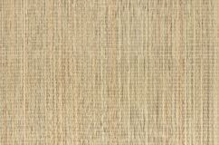 Beige natural mat of dry wicker grass as texture, background. Beige natural mat of dry wicker grass as texture, background stock images
