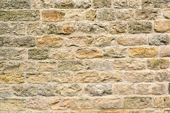 Beige natural stone wall stock photography
