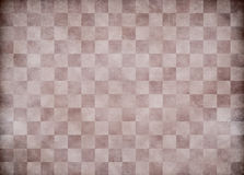 Beige old checkered paper background Royalty Free Stock Photos