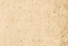 Beige old and scratched paper. Ideal for backgrounds royalty free stock images