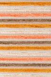 Beige and orange fabric texture Stock Photos
