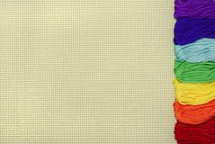 Beige outline with threads. Multi-coloured threads on a beige background Stock Photography