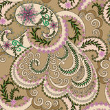 Beige paisley decorated with pink flowers Stock Photos
