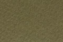 Beige paper background, close up, macro shot. High resolution photo stock image