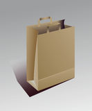 Beige paper bag with handles Royalty Free Stock Photos