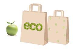 Beige Papiereinkaufstaschen Geschenke Grünes Apfelblatt eco Vektor Stockbild